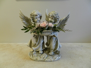 Angel statue with arr from Beck's Flower Shop & Gardens, in Jackson, Michigan